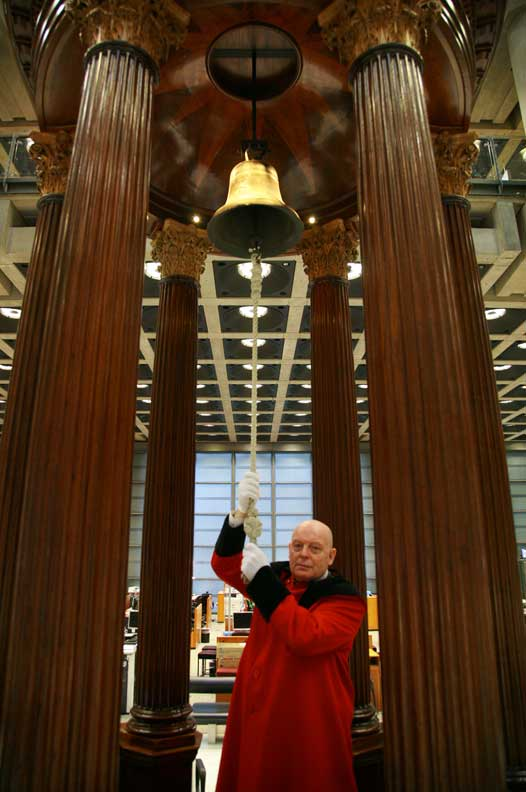 A Lloyd's waiter ringing the Lutine Bell.