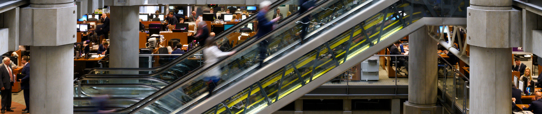 Banner image of escalators in underwriting room